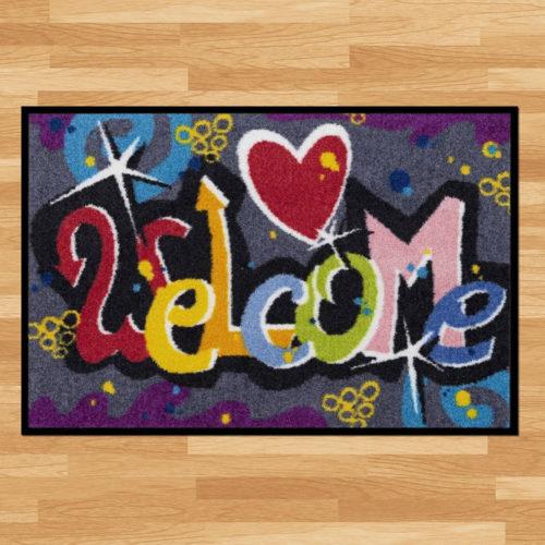 Waschbare Fussmatte «Welcome Graffiti»